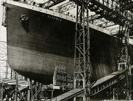 The famous picture of the TITANIC's bow in the gantry. Rumor has it that the name 'TITANIC' was later printed on the picture, because it wasn't yet painted on the bow when the picture was taken.