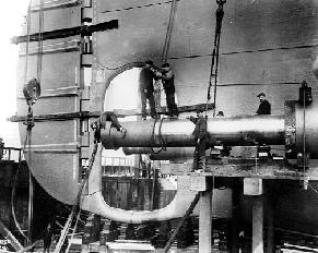 Workers loitering around the TITANIC's empty starboard wing propeller shaft.