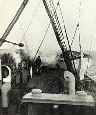 One of TITANIC's empty lifeboats being hoisted aboard the Carpathia with a crane.