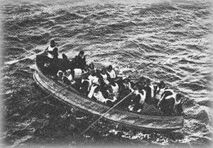 A collapsible lifeboat rowing towards the ship.