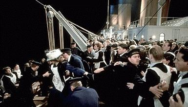 From James Cameron's 'Titanic'; panic sets in on the boatdeck as the crew battles passengers from rushing the boats.