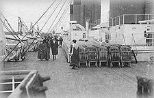 Passengers walking aft along the port boatdeck.